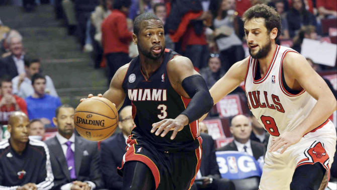 Miami Heat guard Dwyane Wade (3) drives the ball against Chicago Bulls guard Marco Belinelli (8) during the first half of Game 4 of an NBA basketball playoffs Eastern Conference semifinal on Monday, May 13, 2013, in Chicago. (AP Photo/Nam Y. Huh)