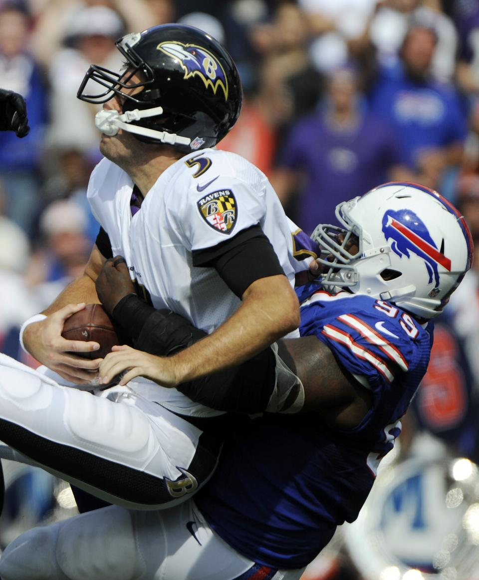 Baltimore Ravens quarterback Joe Flacco (5) is sacked by Buffalo Bills defensive tackle Marcell Dareus (99) during the first half of an NFL football game on Sunday, Sept. 29, 2013, in Orchard Park, N.Y. (AP Photo/Gary Wiepert)
