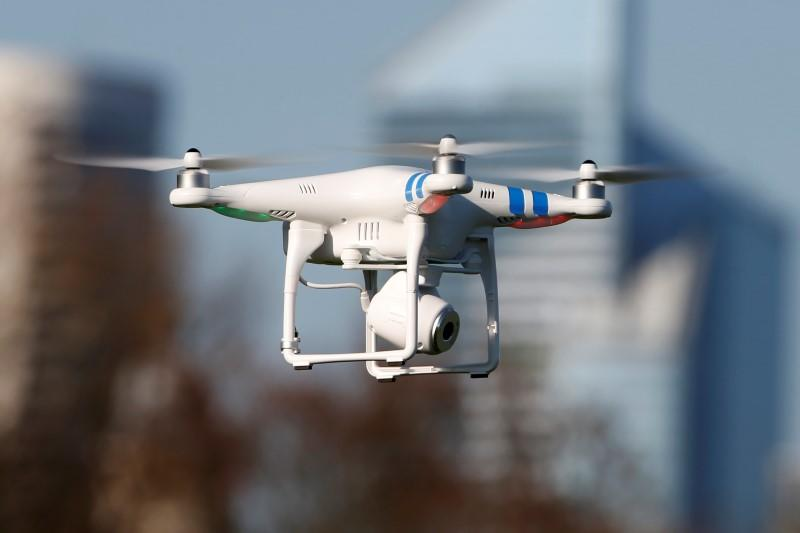 A 'Phantom 2' drone by DJI company flies during the 4th Intergalactic Meeting of Phantom's Pilots ) in an open secure area in the Bois de Boulogne...
