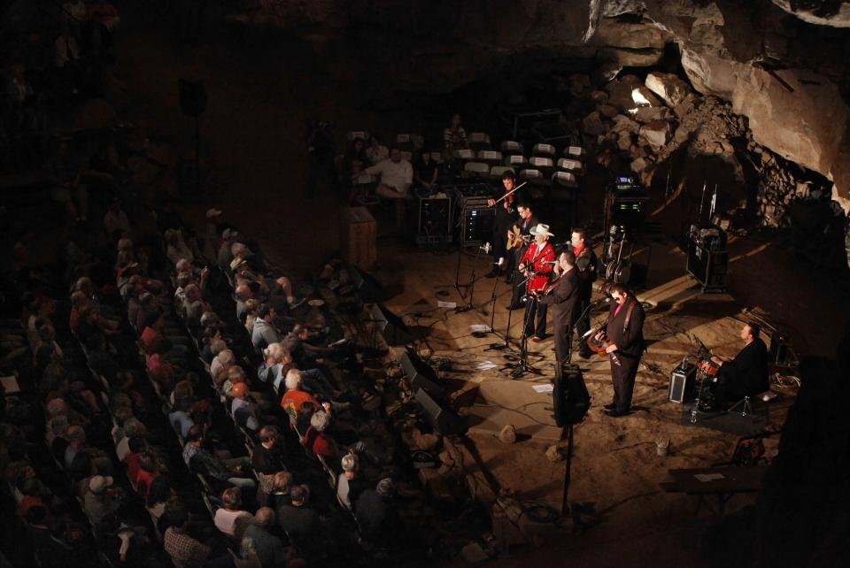 In this July 26, 2011 photo, music fans listen to a performance by Doyle Lawson and Quicksilver in the Volcano Room at Cumberland Caverns, 333 feet below ground, in McMinnville, Tenn. The natural ampitheater is where the Bluegrass Underground radio show is broadcast from once a month. (AP Photo/Mark Humphrey)