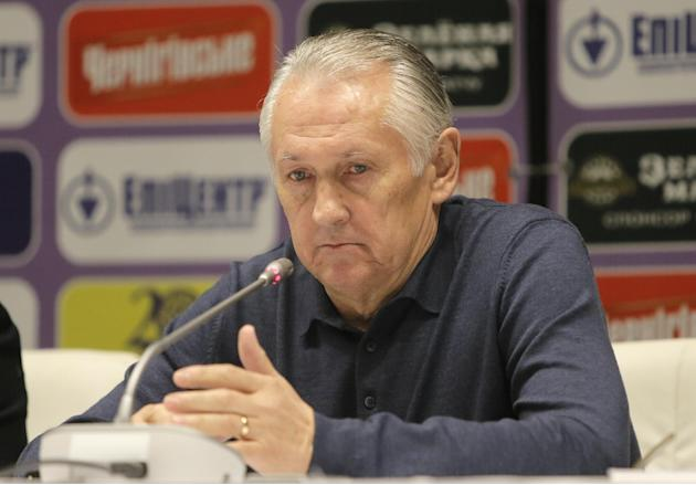 Ukraine's  national soccer coach Mikhail Fomenko attends a news conference at the Olympiyskiy national stadium in Kiev, Ukraine, Thursday, Nov. 14, 2013, ahead of their 2014 World Cup qualifying  play