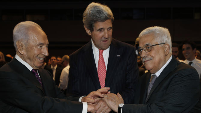 U.S. Secretary of State John Kerry, center, Israeli President Shimon Peres, right, and Palestinian President Mahmoud Abbas all shake hands during the World Economic Forum on the Middle East and North Africa at the King Hussein Convention Centre at the Dead Sea in Jordan Sunday May 26, 2013.  (AP Photo/Pool, Jim Young)