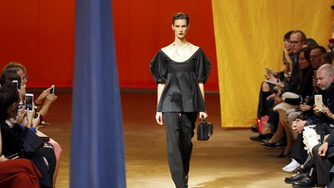 A model presents a creation by fashion house Celine as part of its Spring/Summer 2016 women's ready-to-wear collection during Fashion Week in Paris