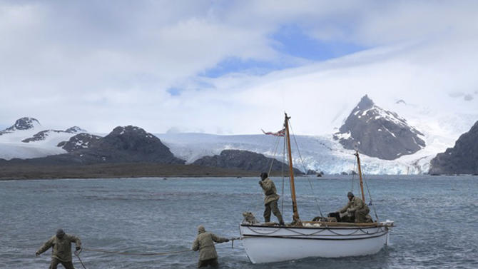 """In this July, 13, 2012 photo released by Shackleton Epic, expedition members pull their boat ashore on Elephant Island during their training. A modern-day team of six led by Tim Jarvis and Barry """"Baz"""" Gray used similar equipment and clothes to re-enact a 1916 expedition led by Ernest Shackleton to save his crew after their ship got stuck in Antarctica's icy waters. They reached an old whaling station on remote South Georgia island Monday, Feb. 11, 2013, 19 days after leaving Elephant Island. Just as Shackleton did in 1916, Jarvis and his team sailed 800 nautical miles across the Southern Ocean in a small lifeboat and then climbed over crevasse-filled mountains in South Georgia. (AP Photo/Shackleton Epic, Jo Stewart)"""