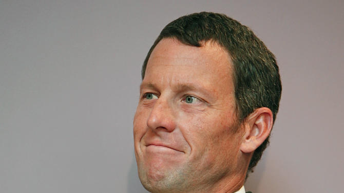 FILE - In this Feb. 28, 2011, file photo, former cycling champion Lance Armstrong smiles during a news conference at the Cedars-Sinai Hospital in Los Angeles.  The foundation created by seven-time Tour de France cycling champion Lance Armstrong has mounted a lobbying campaign on Capitol Hill in an effort to counter accusations by the U.S. Anti-Doping Agency that Armstrong took performance-enhancing drugs throughout much of his career.  (AP Photo/Damian Dovarganes, File)
