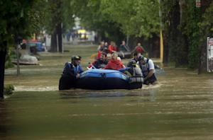 Floods sweep Serbia and Bosnia