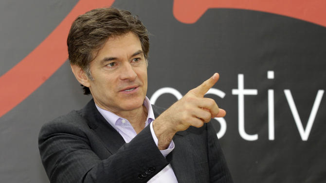 FILE - This June 13, 2012 file photo shows television personality Dr. Mehmet Oz during a photocall at the 2012 Monte Carlo Television Festival in Monaco. On Tuesday, Aug. 20, 2013, Oz rushed to an accident scene after a yellow cab jumped the curb and struck a pedestrian outside New York's Rockefeller Center. Oz says in a statement that emergency medical crews were already treating the injured woman who had a bad leg wound. He says a good Samaritan made a tourniquet out of a belt for the woman. (AP Photo/Lionel Cironneau, File)