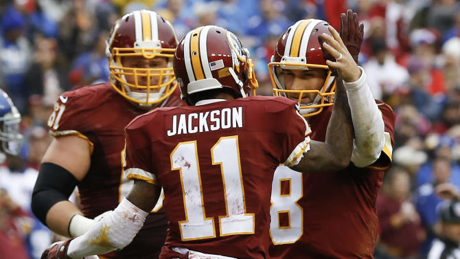 Washington Redskins wide receiver DeSean Jackson (11) celebrates his touchdown with quarterback Kirk Cousins (8) during the first half of an NFL football game against the New York Giants in Landover, Md., Sunday, Nov. 29, 2015. (AP Photo/Patrick Semansky)