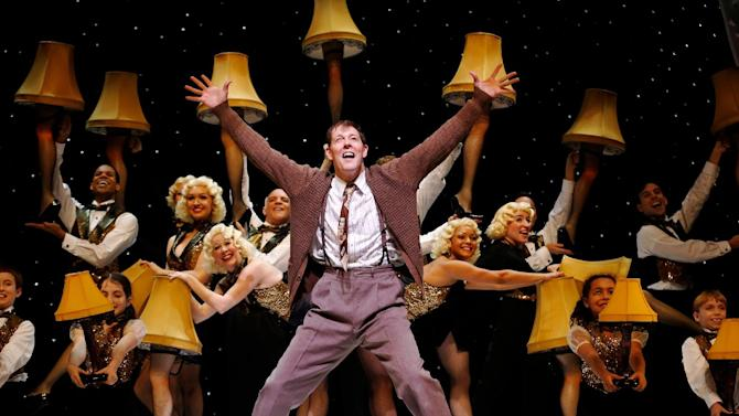 """This theater image released by Keith Sherman & Associates shows John Bolton with the company during a performance of """"A Christmas Story, The Musical"""" in New York. (AP Photo/Keith Sherman & Associates, Carol Rosegg)"""