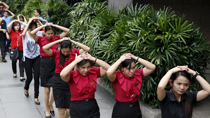 Employees take part in an earthquake drill in Manila's financial district in Makati