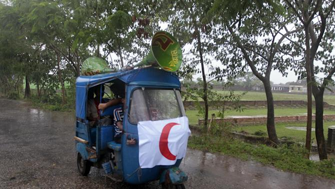 An auto rickshaw is fixed with loudspeakers as volunteers make announcements urging people to move to safer areas, ahead of the coming of tropical cyclone Mahasen, in Chittagong, Bangladesh, Wednesday, May 15, 2013. People living in coastal areas in Bangladesh and Myanmar are being evacuated as cyclone Mahasen appears to make landfall late Thursday or early Friday, according to news reports. (AP Photo/A.M. Ahad)