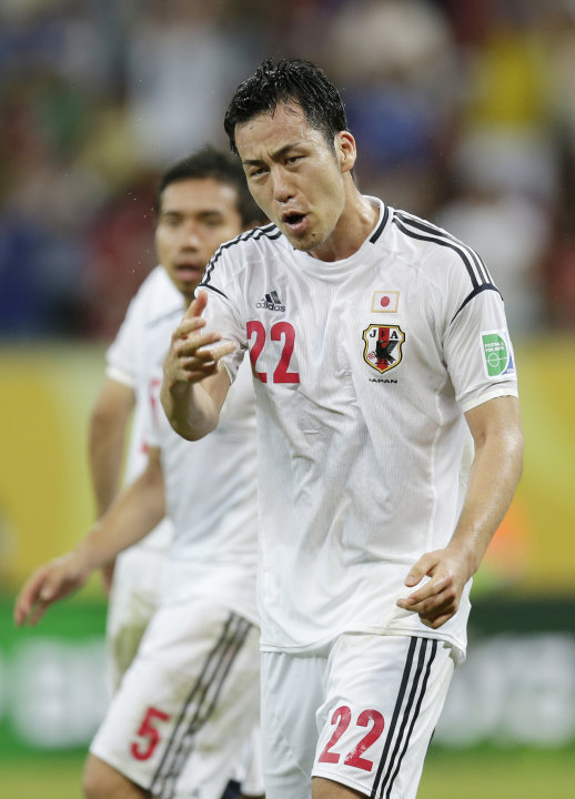 Japan's Maya Yoshida argues a linesman's call after a goal was disallowed due to offside during the soccer Confederations Cup group A match between Italy and Japan at the Arena Pernambuco in Recife, B