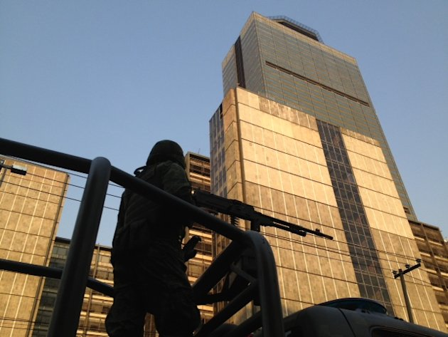 A soldier stands guard outside the Pemex headquarters after an explosion in Mexico City, Thursday, Jan. 31, 2013. Mexico's stated-owned oil company says an explosion at its headquarters in the capital