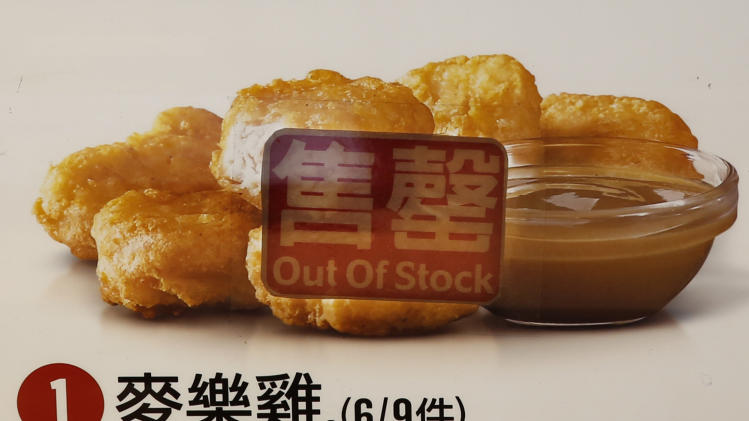 "An ""Out of Stock"" sticker is displayed on a menu picture of chicken nuggets at a McDonald's store in Hong Kong Friday, July 25, 2014. McDonald's restaurants in Hong Kong have taken chicken nuggets and chicken filet burgers off the menu after a U.S.-owned supplier in mainland China was accused of selling expired meat. (AP Photo/Kin Cheung)"