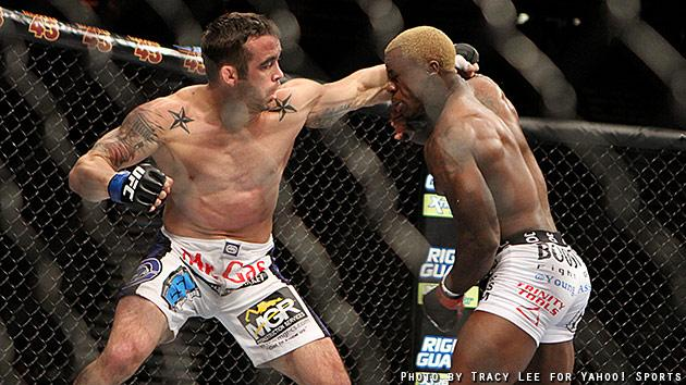 Jamie Varner punches Melvin Guillard during their fight at UFC 155. (Courtesy: Tracy Lee for Y! Sports))