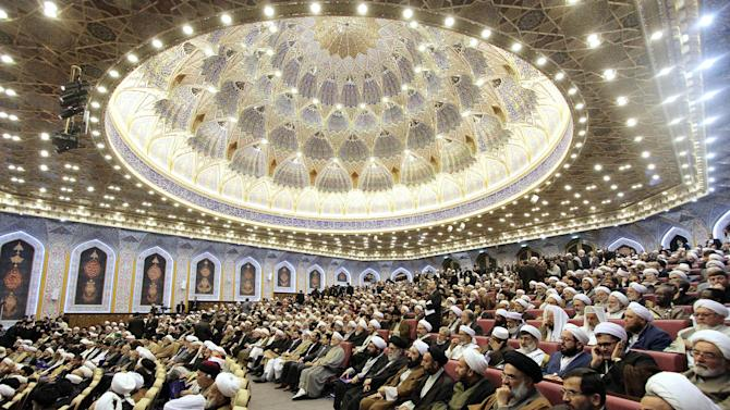 Participants sit in an anti-extremism conference in the city of Qom, 78 miles (125 kilometers) south of the capital Tehran, Iran, Sunday, Nov. 23, 2014. Shiite and Sunni clerics from about 80 countries gathered in Iran's holy city of Qom to develop a strategy to combat extremists including the Islamic State group that has captured large parts of Iraq and Syria. (AP Photo/Mehr News Agency, Zoheir Seidanloo)