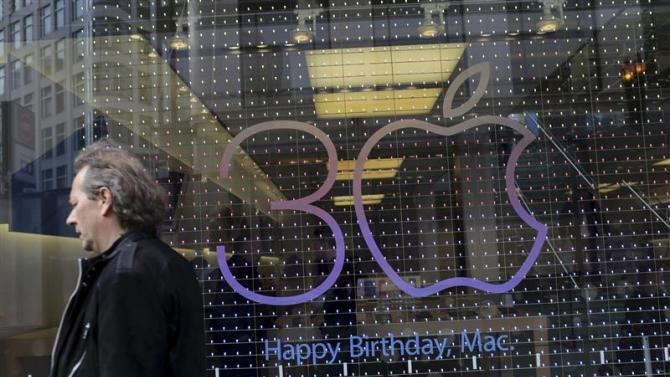 A sign advertising the 30th anniversary of the Macintosh computer is shown at the Apple flagship retail store in San Francisco