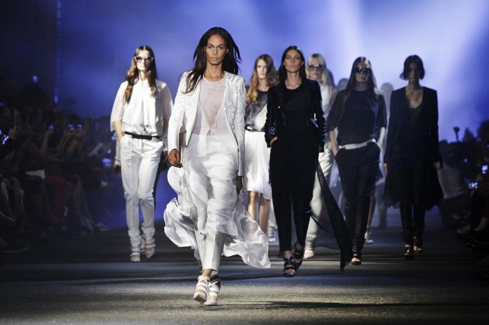 Models walk in the finale of the Prabal Gurung Spring 2013 collection, during Fashion Week in New York,  Saturday, Sept. 8, 2012. (AP Photo/Richard Drew)