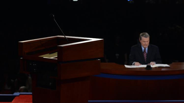 Moderator Jim Lehrer waits for the start of the first presidential debate at the University of Denver, Wednesday, Oct. 3, 2012, in Denver. (AP Photo/Pool-Michael Reynolds)