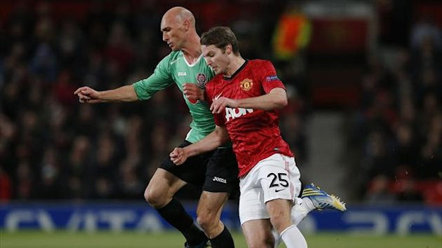 Manchester United's Nick Powell (R) challenges CFR Cluj's Gabriel Muresan during their Champions League Group H match at Old Trafford in