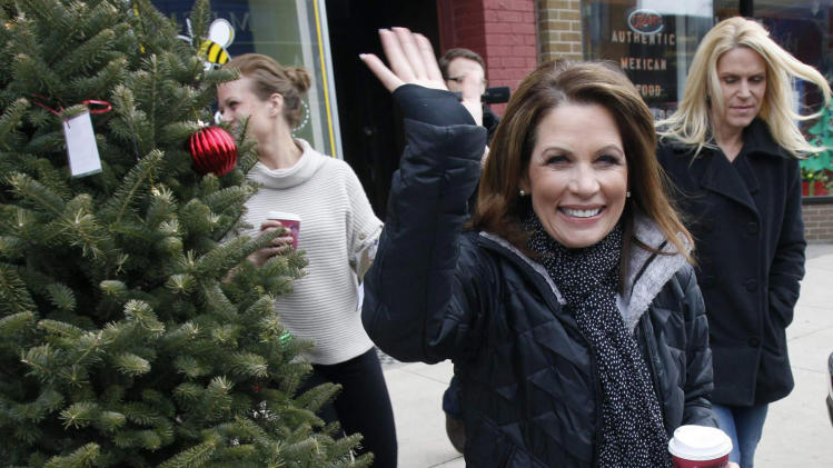 FILE - In this Dec. 19, 2011, file photo then Republican presidential hopeful U.S. Rep. Michele Bachmann, R-Minn., leaves a campaign stop in Hampton, Iowa. The Minnesota Congresswoman, plans to seek re-election following her unsuccessful run for the Republican presidential nomination. Bachmann was recently granted citizenship in Switzerland, according to her spokeswoman. (AP Photo/Charlie Neibergall)