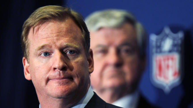 NFL commissioner Roger Goodell announces that NFL owners have agreed to a tentative agreement that would end the lockout pending the players approval on Thursday, July 21, 2011, in College Park, Ga. Carolina Panthers owner Jerry Richardson looks on in the background.  (AP Photo/John Bazemore)