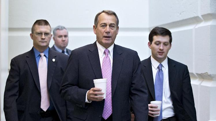 In this Jan. 4, 2013, photo, House Speaker John Boehner of Ohio, walks to a strategy session with GOP members, on Capitol Hill in Washington at the start of the first full day of business for the new 113th Congress. Republicans in Congress who took the politically risky step of voting this week to raise taxes now find themselves trying to fend off potential primary challenges next year from angry conservatives. These lawmakers wasted little time in attempting to deliver an explanation that would be acceptable to the tea party and the GOP's right flank, and, perhaps, insulate themselves from a re-election battle against a fellow Republican. They've started defending the vote as one that preserves tax cuts for most Americans, while promising to fight for spending cuts in upcoming legislative debates over raising the nation's borrowing limit. (AP Photo/J. Scott Applewhite)
