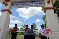 "Cambodian security officials stand guard at main gate of the Extraordinary Chamber in the Courts of Cambodia (ECCC) in Phnom Penh. Cambodia's Khmer Rouge court has delayed freeing the regime's former ""First Lady"", who has dementia, after prosecutors requested tighter conditions for the genocide suspect's release"