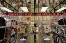 A shopper walks in Fast Retailing's Uniqlo casual clothing store in Tokyo