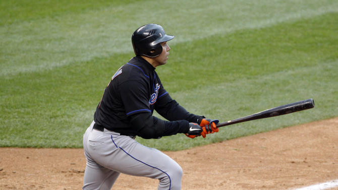 New York Mets' Carlos Beltran watches his ninth-inning, two-run home run clear the scoreboard during a baseball game against the Colorado Rockies in Denver on Thursday, May 12, 2011. It was the third two-run homer of the game for Beltran as the Mets beat the Rockies 9-5. (AP Photo/Ed Andrieski)