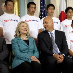 Secretary of State Hillary Rodham Clinton sits with Major League Baseball hall of famer, former Baltimore Oriole Cal Ripken Jr., as they meet with players from the tsunami-devastated areas of Japan who are participating in a sports exchange program between the US and Japan, Tuesday, Aug. 9, 2011, at the State Department in Washington.  (AP Photo/Evan Vucci)