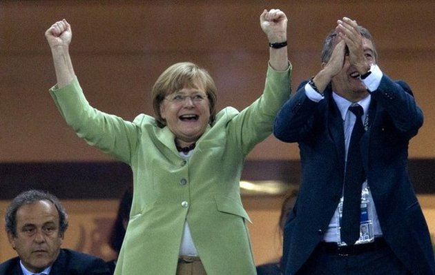 Merkel: much happier than Platini (AP)
