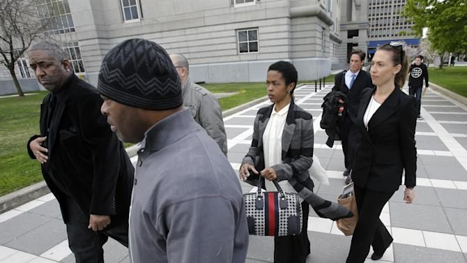"""Singer Lauryn Hill, center, walks from federal court in Newark, N.J., Monday, April 22, 2013, after a judge postponed her tax evasion sentencing and scolded the eight-time Grammy winner for reneging on a promise to make restitution. Hill pleaded guilty last year to not paying federal taxes on $1.8 million earned from 2005 to 2007. At that time, her attorney said she would pay more than $500,000 by the time of her sentencing. It was revealed Monday in court that Hill has paid $50,000. The South Orange resident got her start with The Fugees and began her solo career in 1998 with the acclaimed album """"The Miseducation of Lauryn Hill."""" (AP Photo/Mel Evans)"""