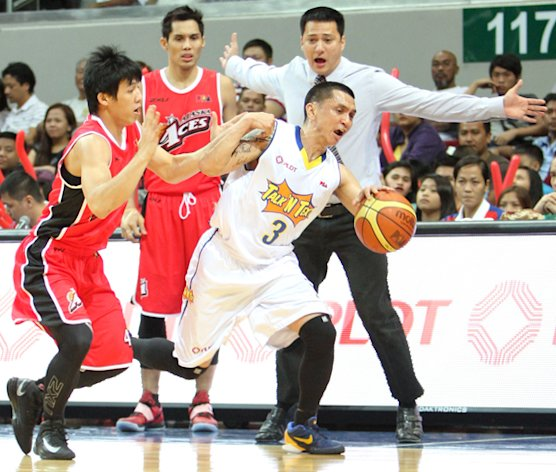 TNT's Jimmy Alapag is fouled by Alaska's Raffy Reyes. (PBA Images)