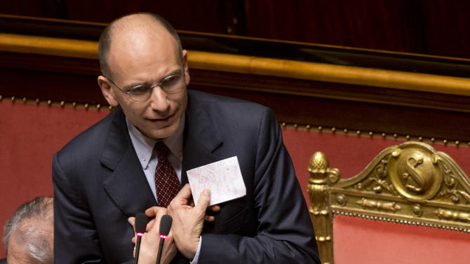 Italian Premier Enrico Letta speaks at the Senate in Rome, Tuesday, April 30, 2013. Italian Premier Enrico Letta's cross-party government won a final vote of confidence vote in Parliament on Tuesday, giving life to a grand coalition that aims to put aside decades of animosity to return the eurozone's third-largest economy to growth. (AP Photo/Alessandra Tarantino)