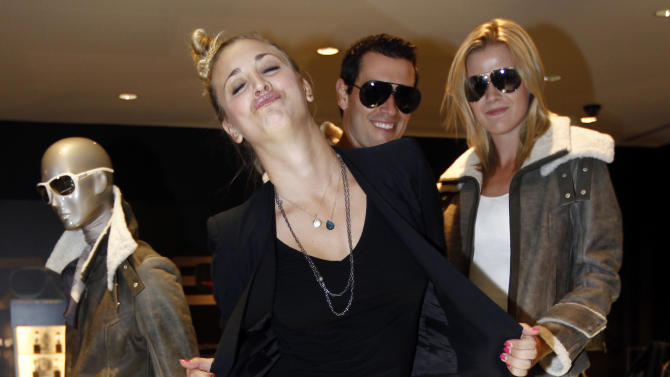 """Actress Kaley Cuoco from the CBS comedy """"The Big Bang Theory,"""" poses for a photo inside the Porsche Design store during Fashion's Night Out on Rodeo Drive in Beverly Hills, Calif., Thursday, Sept. 8, 2011.  Fashion's Night Out is a global event created restore consumer confidence and boost the economy of the fashion industry.  (AP Photo/Matt Sayles)"""