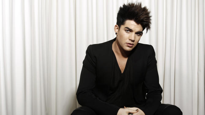"FILE - In this Jan. 23, 2012 file photo, musician Adam Lambert poses for a portrait in Beverly Hills, Calif. Lambert will host and perform at the ""VH1 Divas""  event on Dec. 16, in New York. Miley Cyrus, Demi Lovato, Kelly Rowland, Jordin Sparks and Ciara will also hit the stage at the special honoring dance music and its current and classic divas. Tributes to Whitney Houston and Donna Summer are also planned. (AP Photo/Matt Sayles, file)"