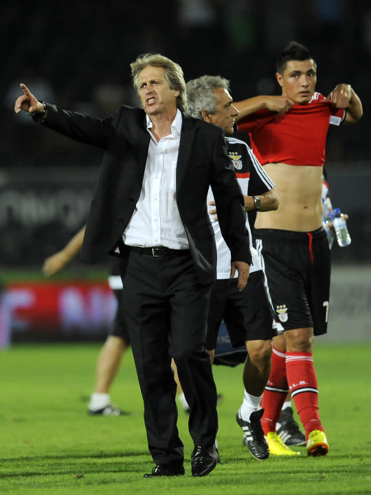 Benfica's coach Jorge Jesus points towards the fans on the stands after their victory over Vitoria Guimaraes in a Portuguese League soccer match at D. Afonso Henrique stadium in Guimaraes, Portugal, S