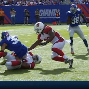 Arizona Cardinals running back Robert Hughes recovers Giants fumble