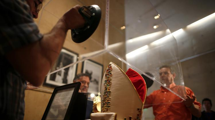 Workmen lower a glass case over papal artefacts in a chapel created to honor the canonization of Popes John Paul II and John XXIII in Los Angeles