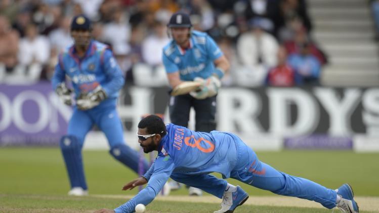 India's Jadeja fails to stop a ball hit by England's Bell during the third one-day international cricket match against India at Trent Bridge cricket ground, Nottingham