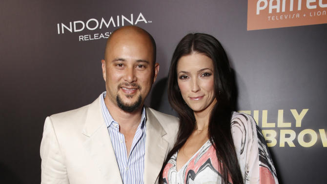 "Cris Judd and  Kelly Wolfe attend Pantelion's ""Filly Brown"" Los Angeles Premiere Hosted by the Rivera Family at the Regal LA Live Stadium on April 17, 2013 in Los Angeles. (Photo by Todd Williamson/Invision for Pantelion Films/AP Images)"