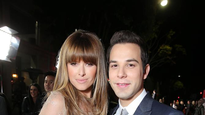 """Sarah Wright and Skylar Astin arrive at the LA premiere of """"21 and Over"""" at the Westwood Village Theatre on Thursday, Feb. 21, 2013 in Los Angeles. (Photo by Eric Charbonneau/Invision/AP)"""
