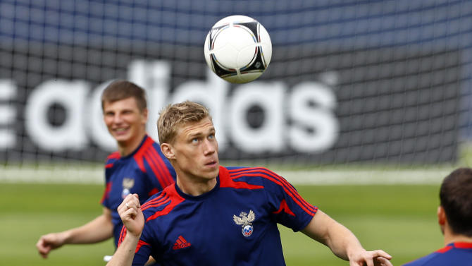 Russia's Pavel Pogrebnyak heads the ball during a training session of Russia at the  Euro 2012 soccer championship in Sulejowek, Poland, Sunday, June 10, 2012. (AP Photo/Sergey Ponomarev)