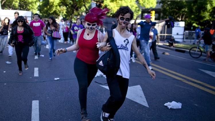 """Lady Gaga fans arrive at the venue where the U.S. pop star will perform a concert, in Buenos Aires, Argentina, Friday, Nov. 16, 2012. The Latin American leg of her, """"Born This Way Ball Tour,"""" is coming to an end but not before stopping in Chile, Peru and Paraguay. (AP Photo/Natacha Pisarenko)"""