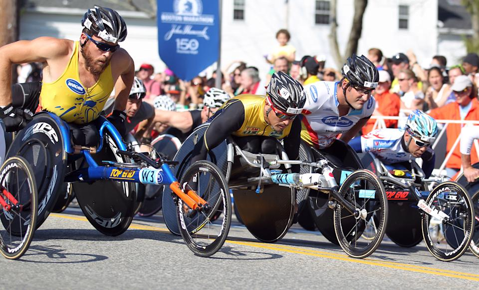 From left, Kurt Fearnley, of Australia, Masazumi Soejima, of Japan,  and Ernst Van Dyk, of South Africa, start the wheelchair division of the 116th running of the Boston Marathon, in Hopkinton, Mass., Monday, April 16, 2012. (AP Photo/Stew Milne)