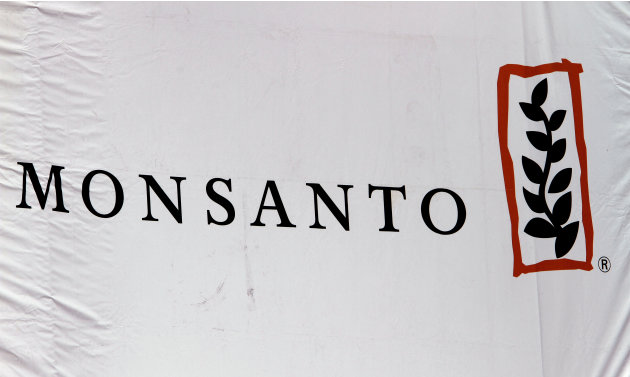 FILE - This Aug. 31, 2011 file photo shows the Monsanto corporate logo at their exhibit booth during the Farm Progress Show, in Decatur, Ill. Marches and rallies against seed giant Monsanto are gettin