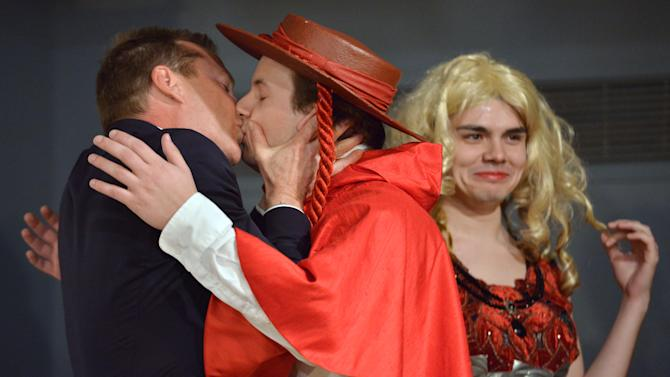 Actor Kiefer Sutherland kisses an actor during his roast as he is honored as the Hasty Pudding Man of the Year at Harvard University in Cambridge, Mass., Friday, Feb. 8, 2013. Sutherland received the pudding pot from the nation's oldest undergraduate drama troupe. (AP Photo/Josh Reynolds)