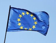 <p>The flag of the European Union flies in Berlin. The eurozone is heading for slow recovery from recession later this year but Spain and France will miss deficit targets, the EU said on Friday, piling pressure on countries already facing budget cuts.</p>