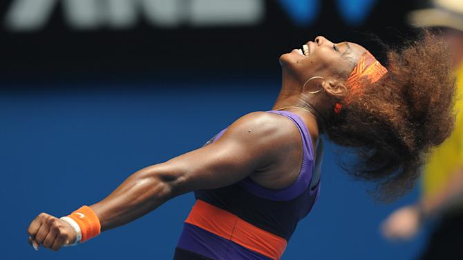 Serena Williams of the US celebrates after defeating Spain's Garbine Muguruza in their second round match at the Australian Open tennis championship in Melbourne, Australia, Thursday, Jan. 17, 2013. (AP Photo/Andrew Brownbill)